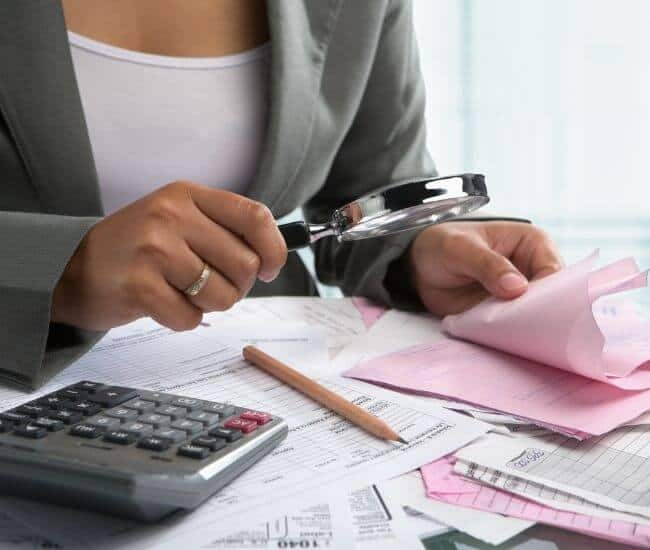 what entry is required in the company's accounts to record outstanding checks